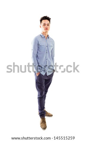 Casual young man with hands in his pockets, studio shot, full lenght body. - stock photo