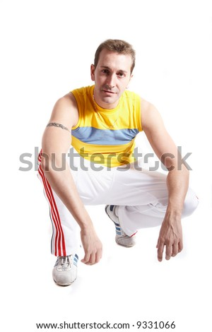 Casual young man with sportive clothes isolated on white - stock photo