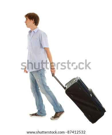 casual young man with suitcase, full length, white background - stock photo