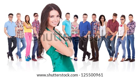 casual young woman as a leader of a young large team - stock photo