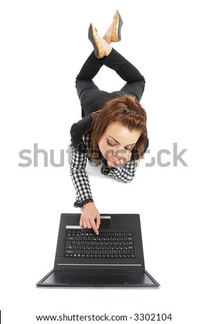 Casual young woman browsing on a laptop computer - check my portfolio for similar photos - stock photo