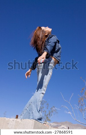 Casual young woman in blue jeans - stock photo