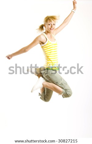 casual young woman jumps in the air