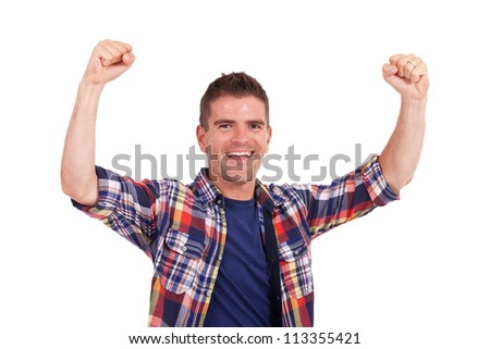 casual young woman making the thumbs up ok sign in front of a group of young people smiling - stock photo