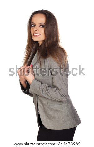 Casual young woman over a white background.