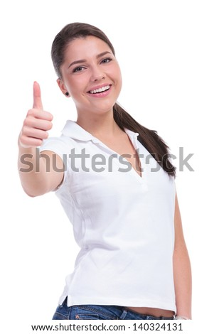 casual young woman shows the thumbs up sign while smiling to the camera. isolated on white background - stock photo