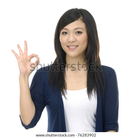 casual young woman smiling doing the ok sign - stock photo