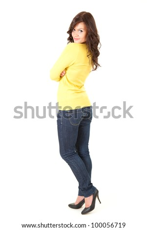 casual young woman with folded arms, full length, white background