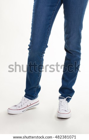 Casual youth clothing. Girl in jeans and gumshoes.