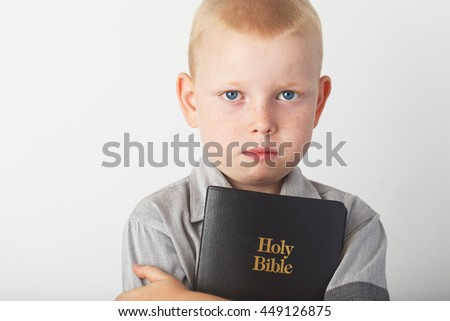Casually Dressed Christian Boy Holding Holy Bible. High quality picture - stock photo