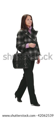 Casually dressed woman with a bag, walking,isolated against a white background.