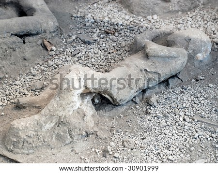Casualty of disaster in Pompeii, dead body covered with dust - stock photo