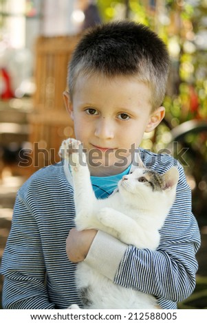 cat and boy - stock photo