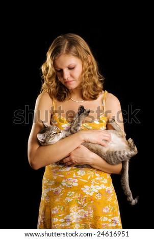 Cat and cute girl in orange dress - stock photo