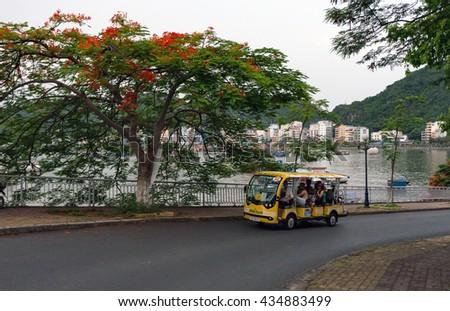 CAT BA, VIET NAM, June 10, 2016 Electric vehicle traffic, in the Bay Cat Ba, Hai Phong, Vietnam