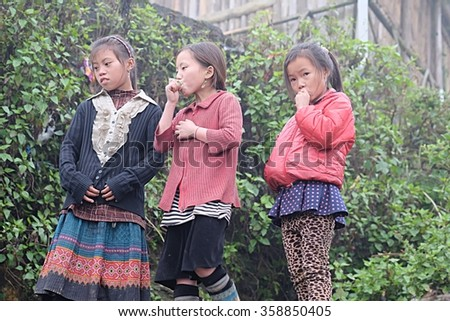 CAT CAT VILLAGE, SAPA, LAO CAI, VIETNAM - JANUARY 2016 : Vietnamese ethnic H'mong children in traditional costumes are playing. H'Mong is one of the minority groups in Vietnam.