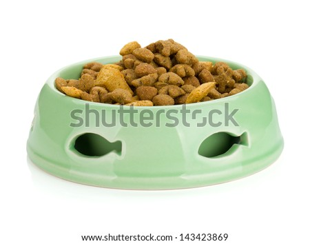 Cat food in a bowl. Isolated on white background - stock photo
