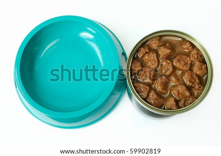Cat food in a can and a feeding barge - stock photo