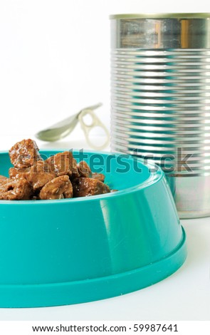 Cat food in a feeding barge with a can - stock photo