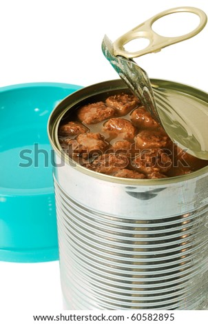 Cat food in an opened can closeup with a feeding barge isolated on white - stock photo