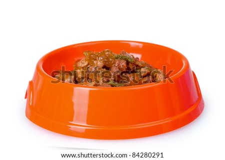 Cat food in bowl isolated on white - stock photo