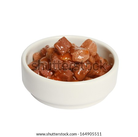 Cat food in bowl on white background