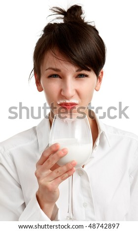 cat girl with milk mustache - drinking milk - on white background - stock photo