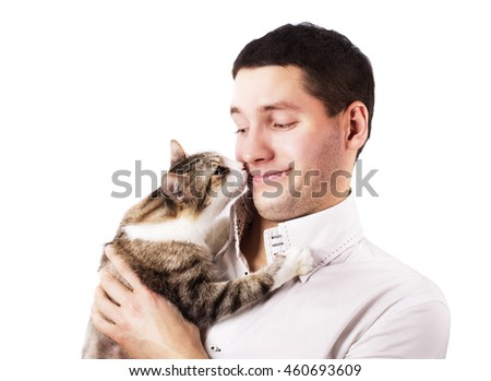 cat hugs the neck and sniffing a cute man isolated on white