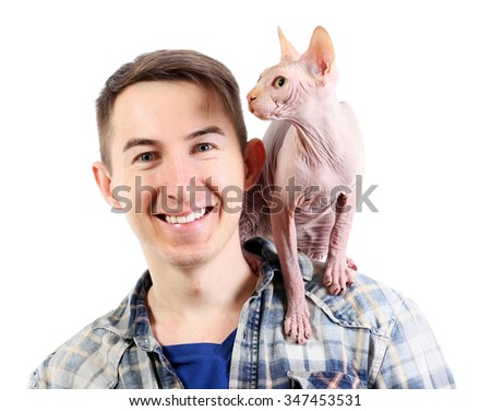 Cat sphynx sitting on young man shoulders, isolated on white