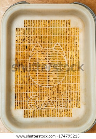 Cat toilet tray with wooden pellets - stock photo