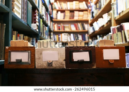 Catalog cards and books in library, closeup - stock photo