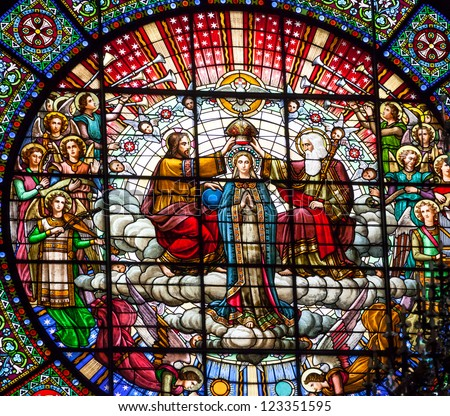 CATALONIA, SPAIN-OCTOBER 18:  Stained glass Jesus crowning Mary God the father in rose window basilica inside Monestir Monastery of Montserrat, Barcelona, Catalonia, Spain on October 18, 2012. - stock photo