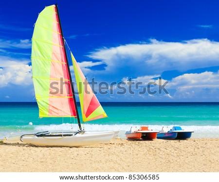 Catamaran and water bikes at the cuban beach of Varadero - stock photo