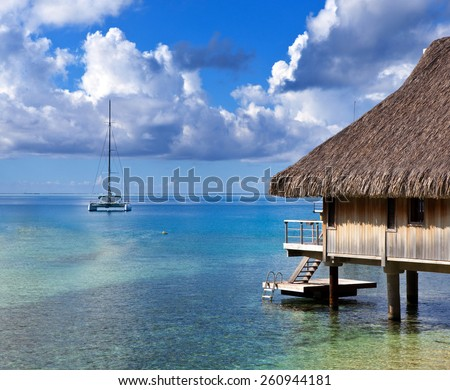 Catamaran and wooden hut at the sea. - stock photo