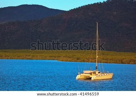 Catamaran in Cairns Harbor - stock photo