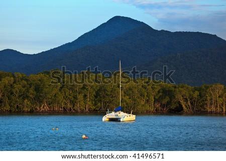 Catamaran Moored in Cairns Harbor - stock photo