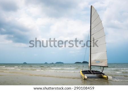 Catamaran sailboat on a tropical beach at Koh Chang island, Thailand - stock photo