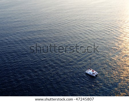catamaran yacht on sea at sunset - stock photo