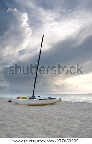 Catamarans on a Cuban Beach at Sunset - stock photo