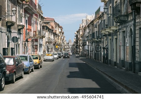 CATANIA, Sicily, ITALY - JUL 25, 2016: Street leading to the Cathedral of Saint Agatha in Catania, Sicily