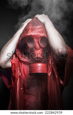 catastrophe nuclear concept, man with red gas mask - stock photo