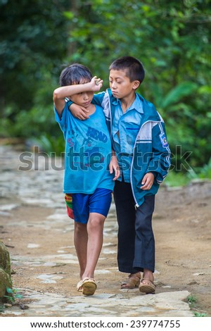 CATCAT, VIETMAN - SEP 20, 2014: Unidentified Hmong two boys walk in CatCat village, Vietnam. Hmong is a minority ethnic group of Vietnam