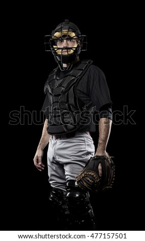 Catcher Player with a black uniform on a black background.