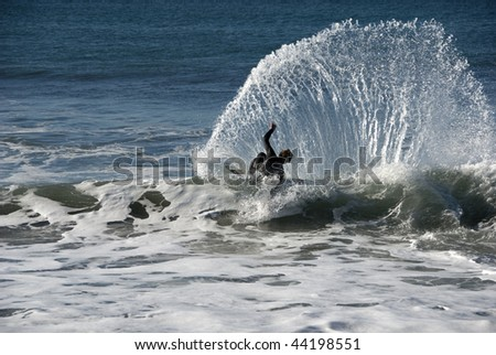 Catching a wave - stock photo