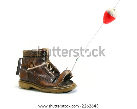 Catching an old shoe with a fishing pole. White background - stock photo