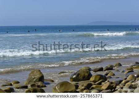 Catching big waves between Ventura City Beach and distant Channels Islands, Southern California - stock photo