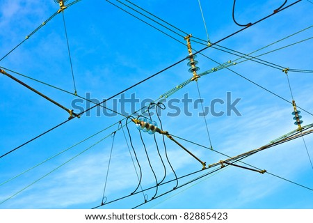 catenary in winter at the station - stock photo