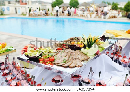 catering buffet food outdoor in luxury restaurant with meat and colorful fruits - stock photo