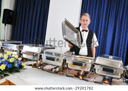 catering buffet food party preparation man - stock photo