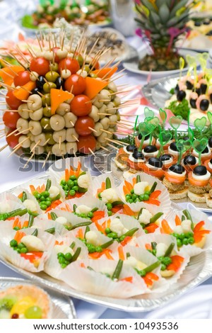 Catering buffet style - different light snack and sandwiches - stock photo